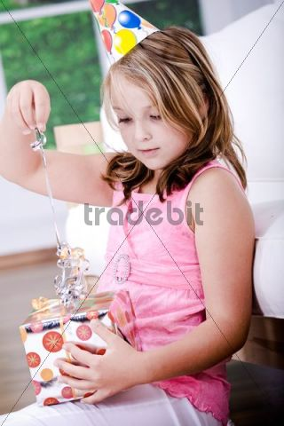 Young girl with gift, celebrating her birthday