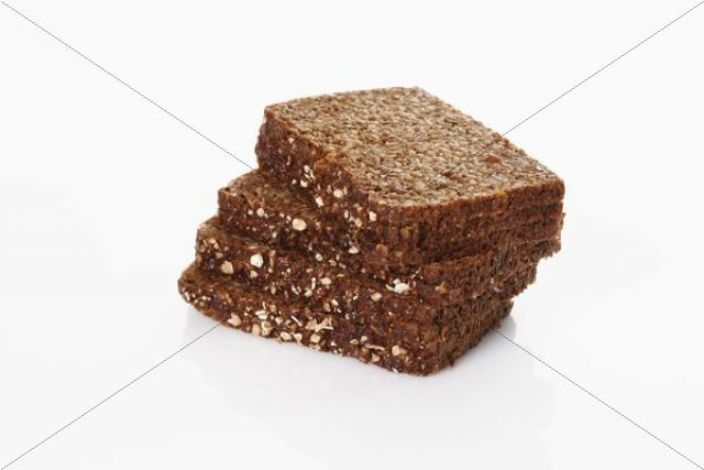 Slices of dark whole-grain bread with oatmeal, stacked