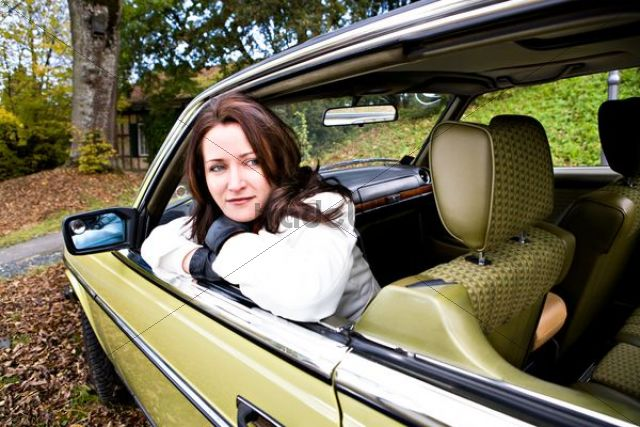 Young woman in a post-war classic car