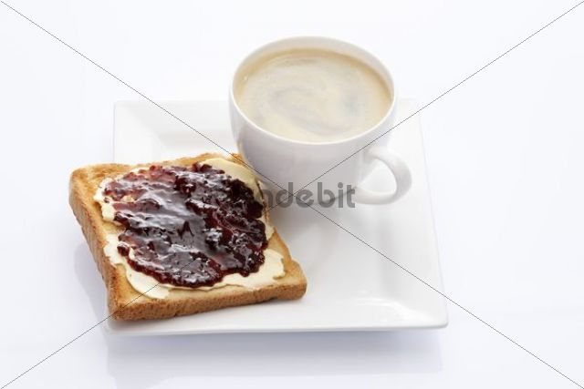 Porcelain plate with a cup of coffee and toast with rosehip and apple jam