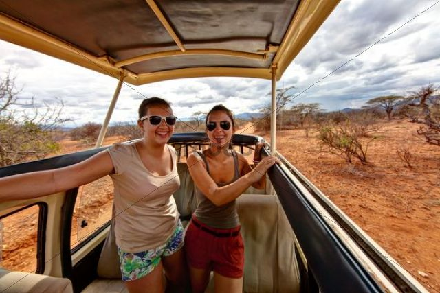 Two girls, about 13 and 18 years, in a safari bus, Samburu National Reserve, Kenya, East Africa, PublicGround