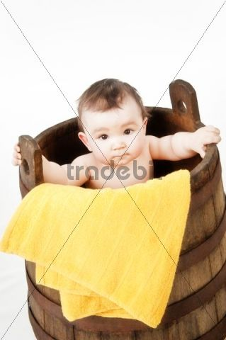 Little child in a wooden tub