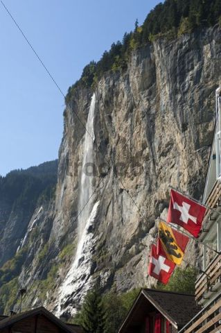 Staubach Falls and flags of Switzerland and the canton of Bern, Lauterbrunnen, Bernese Oberland, Switzerland, Europe