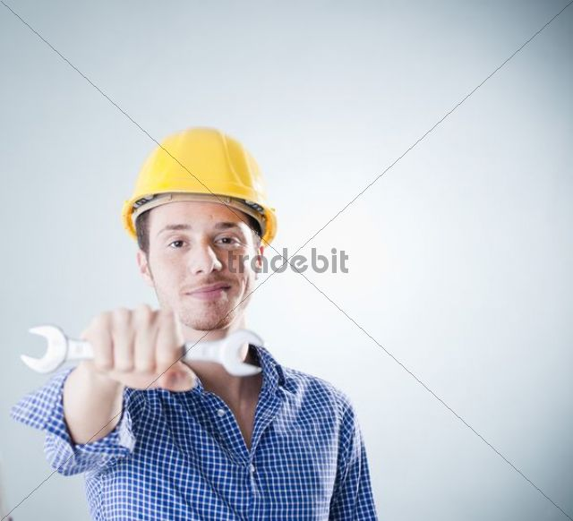 Young craftsman holding a wrench