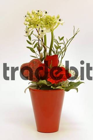 Flower decoration in a red vase
