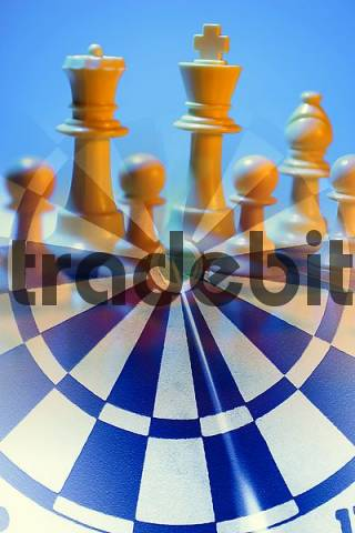 Photo Composite of Chess Pieces and Dartboard