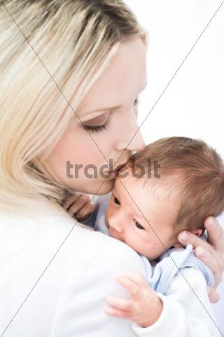 Baby boy, 1 month, being held by his mother