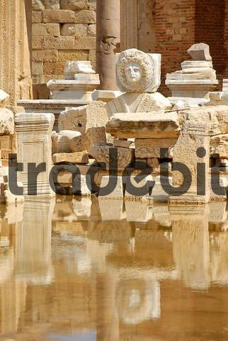 Head of a medusa and other wreckage mirror in water new forum Leptis Magna Libya