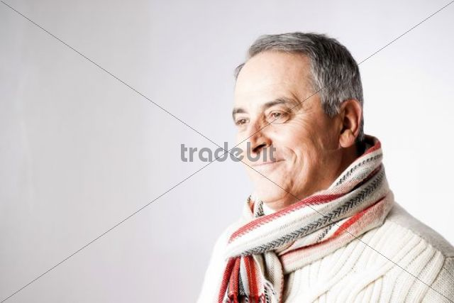 Smiling elderly man wearing a scarf