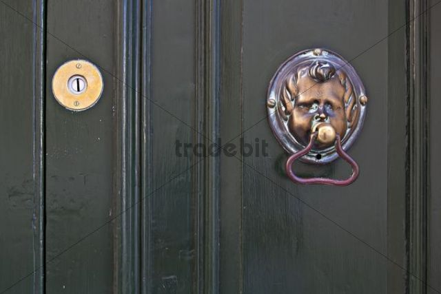 Door knocker shaped like a face on front door, Valletta, Malta, Europe