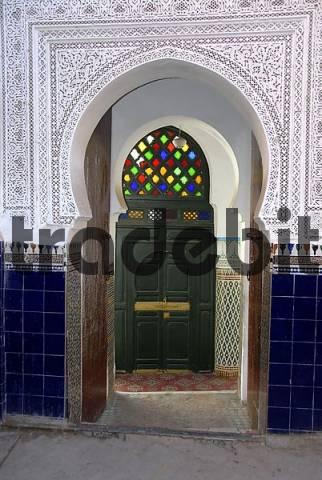 Oriental entrance to a mosque with colourful windows medina Marrakech Morocco