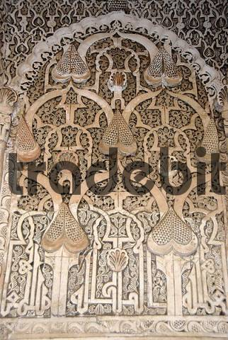 Oriental detail of with fine stucco richly decorated mihrab Medersa Ali Ben Youssef medina Marrakech Morocco
