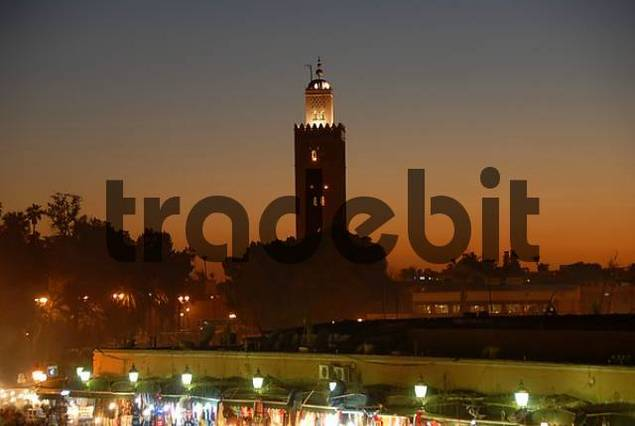 Evening red over square Djemaa el Fna with illuminated Koutoubia minaret Marrakech Morocco