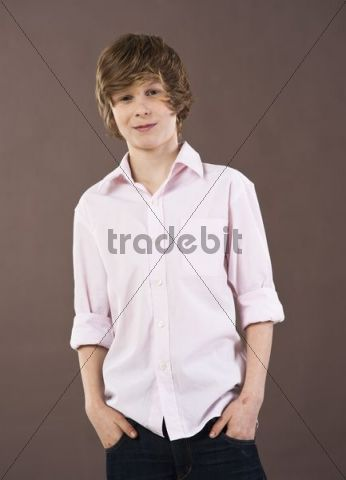Boy wearing a shirt with his hands in his pockets