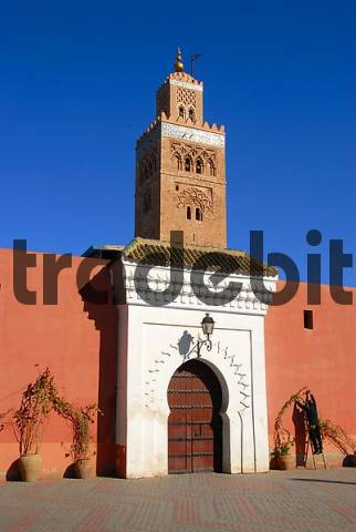 Old minaret and entrance gate Koutoubia mosque Marrakech Morocco
