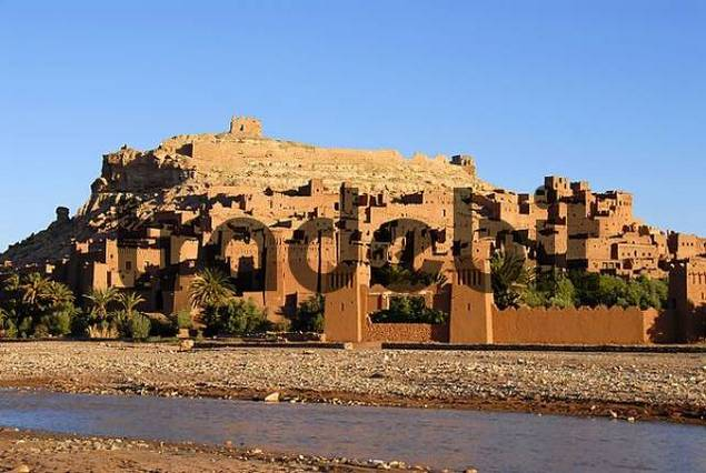 Traditional Berber architecture Kasbah Ait Benhaddou at river and mountain slope Morocco