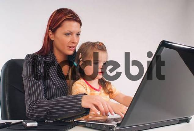 business woman with child using laptop