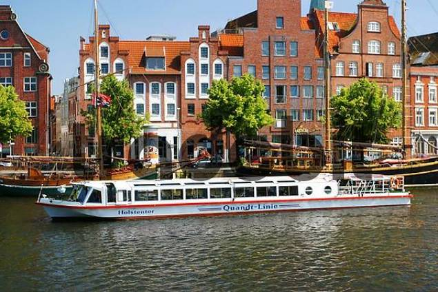 BRD Germany Schleswig Holstein Lübeck at the Under Trave Sightseeing Ship with Tourists Old Trading Houses