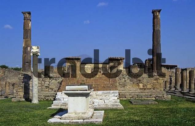 ruins of temple of Apollo in front of Vesuvius excavations of Pompeji in Italy