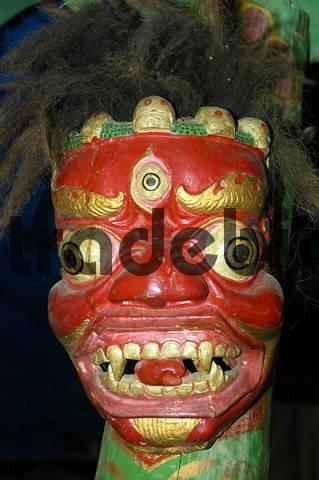 Red ritual terrific mask in the monastery Tashi Gompa Phu Nar-Phu Annapurna Region Nepal