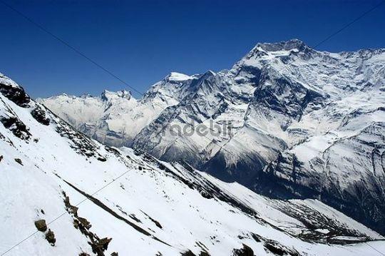 Snow covered high mountains of Annapurna II seen from Kang La Pass Nar-Phu Annapurna Region Nepal