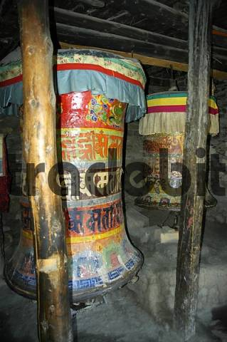 Very old prayer wheels with coloured Nepali script Braga Gompa Annapurna Region Nepal