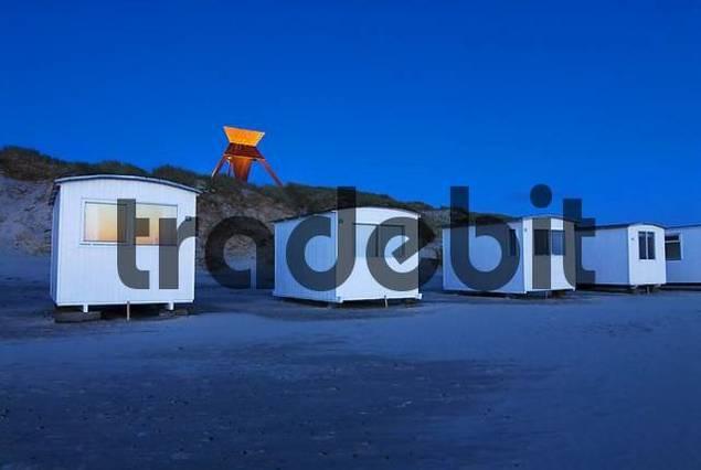 Typical huts at the beach in Blokhus near Loekken at dusk, Jutland, Denmark