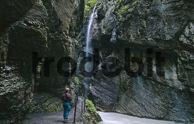 woman walking through ravine of Partnach in Garmisch Partenkirchen Bavaria Germany