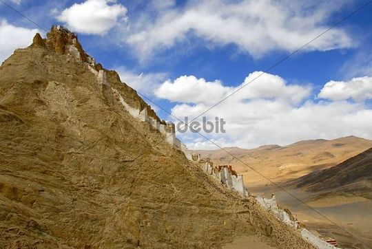 old fortress dzong on the mountain top with steep wall