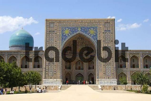 Iwan decorated with colourful tiles and blue cupola Madrasah Tilla-Kari Registan Samarkand Uzbekistan