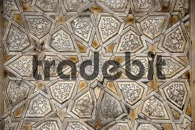Geometric wood carving at the entrance gate to Madrasah Kukeldash Bukhara Uzbekistan