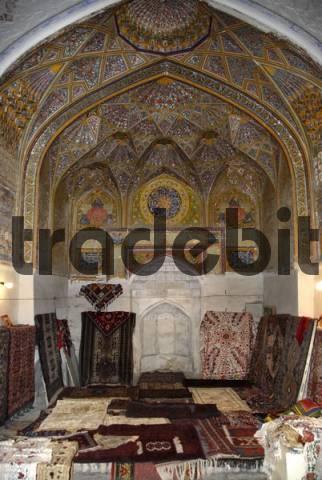 Decorated arch with mihrab now shop selling suzani and carpets in Khanaka Nadir Divan-Begi Lyab-i Hauz Bukhara Uzbekistan