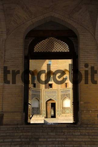 View through the entrance gate of Mosque Kalon to Mir-i Arab-Madrasah Bukhara Uzbekistan