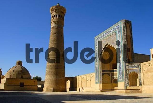 Minaret Kalon with decorated iwan of Mosque Kalon Bukhara Uzbekistan
