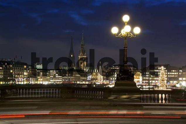 Kennedy bridge, inner Alster lake, glowing christmassy with light traces, Hamburg Germany