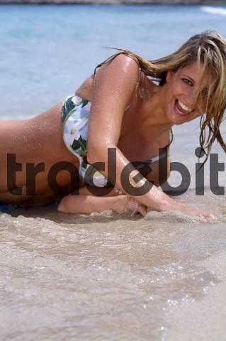 Young woman having fun at the sea, Cala Rajada, Mallorca, Spain