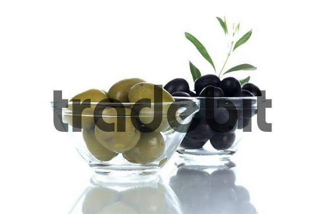 Black and green olives in glass bowls