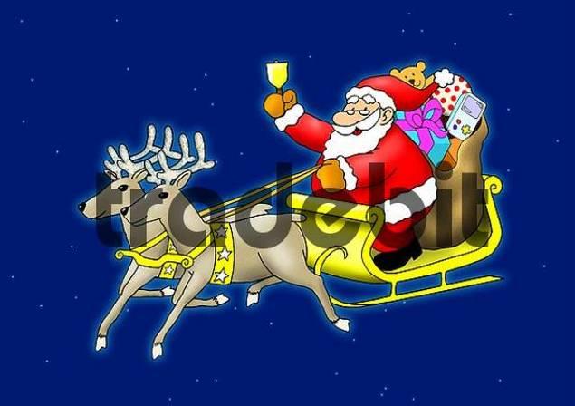 Santa Claus sitting in his sleigh flying with reindeer ...