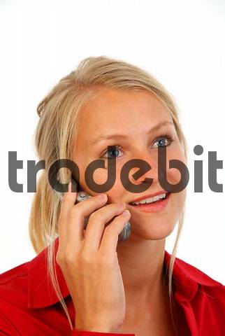 young, blond woman with mobile phone