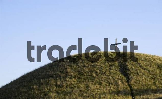 Grass-covered hill with wood-cross in the Hegau/district Konstanz/Baden-Wuerttemberg/Germany