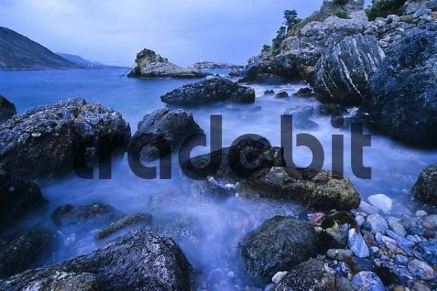 waves on the rocky shore near Agios Gallini, Crete, Greece