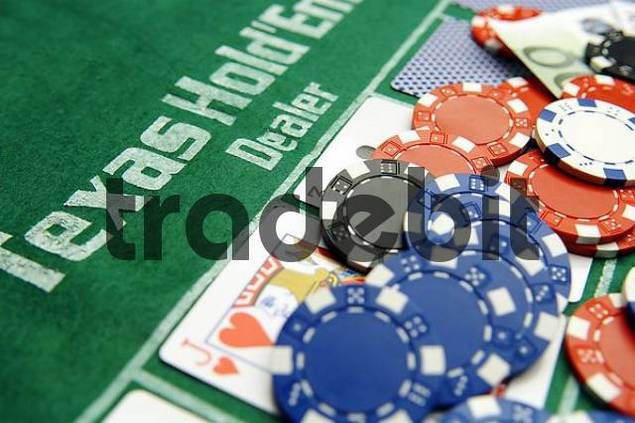 Texas Holdem Poker Dealer with cards and chips