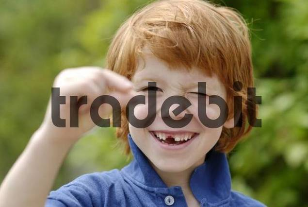 boy with a tooth gap space losing his baby teeth deciduous milk teeth