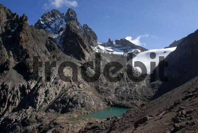 Summit Batian 5199 m Nelion 5188 m and Point Lenana 4985 m with glacier and lake Lewis Tarn Mount Kenya National Park Kenya
