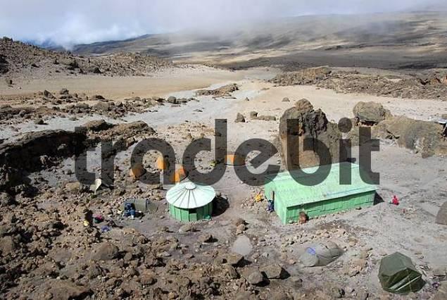 Tents huts and big rocks seen from above School Hut Kikelewa Route Kilimanjaro Tanzania
