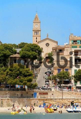 Porto Cristo beach with Dels Dolors church, Mallorca, Spain