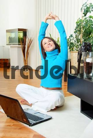 young woman with laptop feels good
