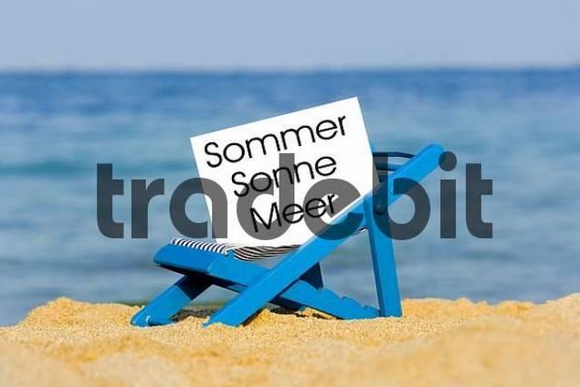 a deckchair with a sign on the beach