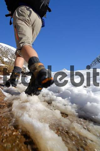 Feet and hiking boots of a hiker, Texel Group, South Tyrol, Italy