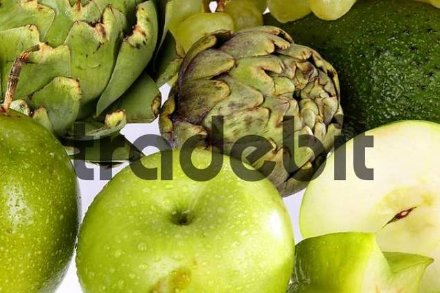 assorted green fruit on white ground